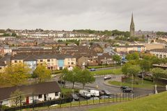 The bogside and St Eugene`s Cathedral. Derry Londonderry. Northern Ireland. United Kingdom royalty free stock photo