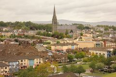 The bogside and St Eugene`s Cathedral. Derry Londonderry. Northern Ireland. United Kingdom. The bogside murals and St Eugene`s Cathedral. Derry Londonderry Stock Photo