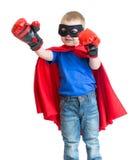 Bohatera dzieciaka chłopiec w maski bawić się odizolowywam Fotografia Royalty Free