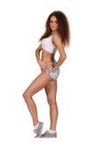 Bohatera sporta kobieta z biel ściany tłem Zdjęcie Royalty Free
