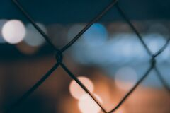 Bohek lights through mesh fence Stock Photography