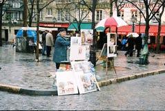 Bohemian artist draws in Paris, France. Stock Images