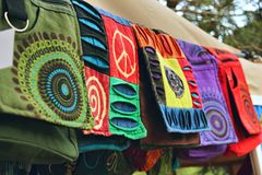 Bohemian bags made from natural materials at a clothes stand in a hippy festival market. Handmade bohemian hippie boho bags made from natural materials at a royalty free stock photo