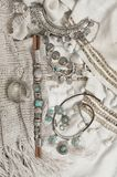Bohemian chic outfit. Bohemian chic silver and turquoise jewelry set on linen clothes. Boho outfit. Top view point Royalty Free Stock Image