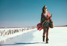 Bohemian chic styled model. Fashion model wearing bohemian chic clothing posing on the salt beach outdoor stock photos