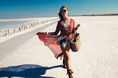 Bohemian chic styled model. Fashion model wearing bohemian chic clothing posing on the salt beach outdoor royalty free stock image