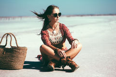 Bohemian chic styled model. Fashion model wearing bohemian chic clothing posing on the salt beach outdoor stock image