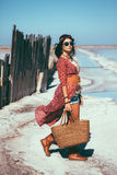 Bohemian chic styled model. Fashion model wearing bohemian chic clothing posing on the salt beach outdoor stock photo