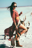Bohemian chic styled model. Fashion model wearing bohemian chic clothing posing on the salt beach outdoor royalty free stock photo