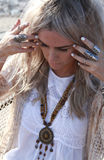 Bohemian fashion. Beautiful blonde haired woman dressed in bohemian style at the beach royalty free stock images