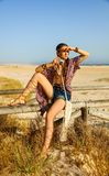 Bohemian girl with retro photo camera looking into the distance Royalty Free Stock Image