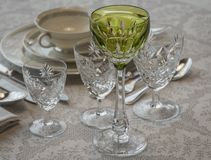 Bohemian Glasses for an Important Dinner. Water and Wine Glasses in Bohemian Crystal and Tall Green Glass for the White Wine of the Rhine stock image