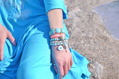 Bohemian greek jewelry advertisement on the beach royalty free stock image