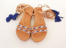 Bohemian greek leather sandals in blue and turquoise colors Stock Images