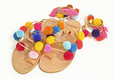 Bohemian greek leather sandals with pom pom Royalty Free Stock Photography
