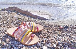 Bohemian greek sandals advertisement on the beach Royalty Free Stock Images