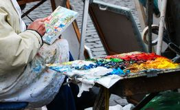 Bohemian painter painting on Montmartre hill in Paris royalty free stock photos