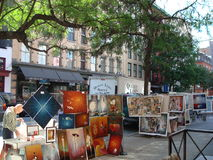 Bohemian Soho. Street artists exhibit their paintings in one of the streets of the bohemian district of the City of New York stock images