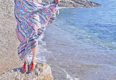 Bohemian style clothes and sandals advertisement Greece Stock Images