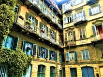 Bohemian style corner in Turin city, Italy. Plants, houses and history. Fascination and beauty, art and architecture, timeless home and fairytale, stylish and royalty free stock photo