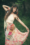 Bohemian style fashion young woman outdoor. Beautiful young bohemian style fashion girl in summer garden royalty free stock image