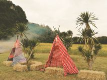 Bohemian style. Outdoors area decorated in a Bohemian style with a tent from colored fabrics stock images