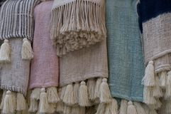 Bohemian style pastel rugs. Close up picture of some pastel colored beautiful bohemian style rugs , located at the famous Love Anchor Market in Canggu, Bali stock image