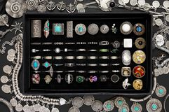 Bohemian style silver jewelry on black. Bohemian style silver jewelry set on black background. Top view point royalty free stock images