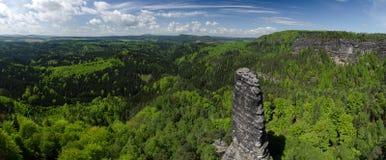 Bohemian Switzerland national park, Czech Republic. Panoramic view of Bohemian Switzerland national park, Czech Republic with solid rock in the foreground royalty free stock image