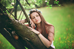 Bohemian woman spring portrait. Bohemian woman leaning on spring tree. Hippie and romantic stock photography