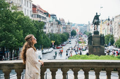 Bohemian woman tourist sightseeing on Wenceslas Square in Prague Stock Photos