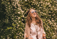 Bohemian young woman among flowers looking up on copy space Stock Images