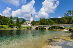 Bohinj Lake. The church dedicated to John the Baptist in Ribcev Laz on the Bohinj Lake, Slovenia Stock Photo