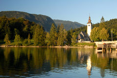Bohinj lake with a church infront Royalty Free Stock Photography