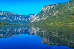 Bohinj lake with Julian Alps reflecting on surface Stock Photos