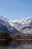 The Bohinj Lake Shore and snowy mountains Royalty Free Stock Images