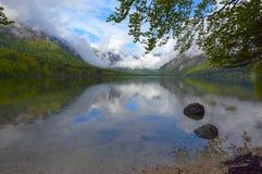 Bohinjsko jezero between mountains at spring Royalty Free Stock Photo