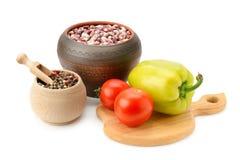 Bohnen im Topf und im Gemüse Lizenzfreies Stockbild