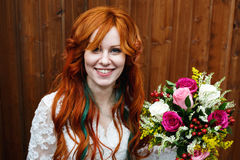 Boho bride with red hair posing Royalty Free Stock Photography