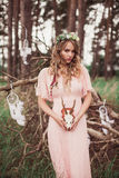 Boho Bride With Whitetail Deer Skull And Antlers. Dream catcher, skull and antlers and gorgeous young boho bride stock photography