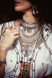 Boho fashion details. Young woman with massive necklace in boho style Stock Photo