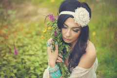 Boho Girl with bouquet of wildflowers. Stock Images