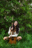 Boho girl with guitar laughing stock images