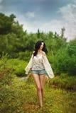 Boho Girl walks in the woods. stock images