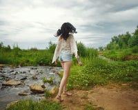 Boho Girl went off along the river bank. Stock Image