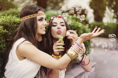 Boho girls playing with bubbles