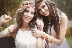 Boho girls. Portrait of two the best friends in park Royalty Free Stock Photos