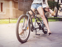 Boho girls riding on bike Royalty Free Stock Photography
