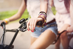 Boho Girls Riding On Bike Royalty Free Stock Photography