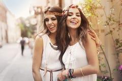 Boho girls on the street royalty free stock photo